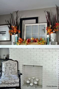 A simple fall-themed mantle adds a perfect pop of color to a neutral living room.