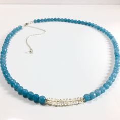 This summer sky necklace was made with the intention of attracting happiness and abundance through connection with your spiritual self.  Made with Citrine, which is associated with your Solar Plexus Chakra, the center of your core self, willpower and personal identity, combined with Angelite a high