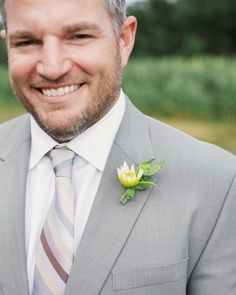 The Groomsmen - Light grey suits and bouts with dahila buds and peppergrass
