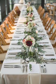 Amazing head table flowers. Bridesmaids bouquets used as centerpieces with seeded eucalyptus as filler down the center. Flowers by Regalo Design.