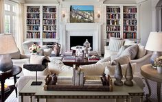 Architectural Digest - living rooms - ombre, lilac, lamps, console, table, white, sofas, built-ins, flanking, marble, fireplace, built-in ca...