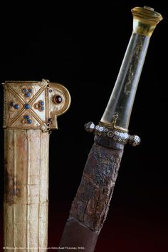 """A beautiful jeweled sheath and dagger from the early middle ages, 5th century A.D. [Roman-]Germanic."""