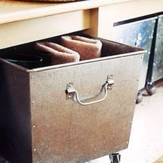 Rolling storage bins for storage under bench seating.  I love furniture on casters!
