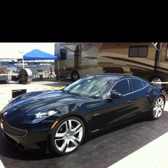 A Fisker Karma electric car. I would look so great in this car.  Like a female James Bond.
