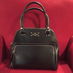 Authentic Kate Spade Bag Mint condition but pre-loved Kate Spade bag. Clean throughout and only used a few times. Makes a great work bag. Please use the offer button - reasonable offers will be considered. kate spade Accessories