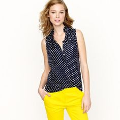 J. Crew Navy Polka Dot Ruffle Sleeveless Tank Top In new condition. Beautiful and flowy. Being sold right now on J. Crew for $110! But unfortunately too popular and is sold out. J. Crew Tops Tank Tops