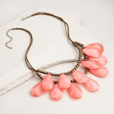 With luminous coral beads on a suede cord, our statement necklace creates a fresh take on a vintage design. This versatile piece is sure to become an everyday accessory favorite.