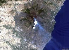 Landsat images: Violent Earth: With a 16-day repeat to every place on the land surface, there is a good chance that a volcanic eruption will be recorded. This picture shows Mount Etna, Italy, blowing its top once again, this time in 2001.