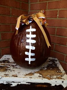 Cool football pumpkin decoration....just spray painted brown, then striped with white.