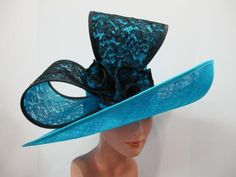 Herald and Heart large brim hat with lace-covered bow. Perfect for the Kentucky Derby, The Royal Ascot, weddings or any special occasion.