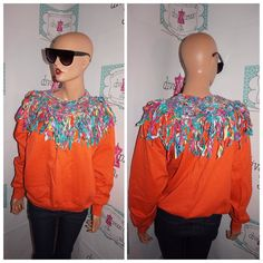 """Up for sale is this lovely Vintage Orange Shingle Sweat Shirt Size L  Flaws: none noticeable  Material:  cotton  Shoulder Pads: no Pit to Pit: """" 24 Sleeve: """" 22 Overall Length: """" 24  PLEASE READ Below Tag size on vintage clothing doesnt match current clothing sizes. Please compare the actual garment measurements below to your own clothing (not your body) to determine fit. Measurements have been taken with the garment lying flat. They have not been doubled. The tag inside the garment may not…"""