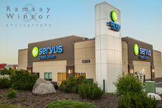A sunrise Architectural exterior of the new Serus Credit Union building located in Grande Prairie Alberta.