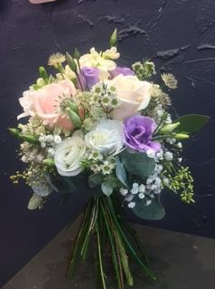 Wedding Bouquet: Gypsophila, White Lisianthus, Lavender Lisianthus, White Wax Flower, Cream Stock, Sweet Avalanche Roses, Eucalyptus With Berries,