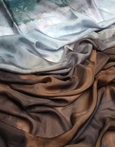 could we use a softer silk for the scarves and use more contemporary colors - light and dark greys etc.
