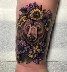 Brown bear with sunflowers and flowers wrist tattoo Wrist Tattoo Cover Up, Flower Wrist Tattoos, Wrist Tattoos For Guys, Sleeve Tattoos For Women, Bear Tattoos, Mom Tattoos, Body Art Tattoos, Traditional Bear Tattoo, Black Bear Tattoo
