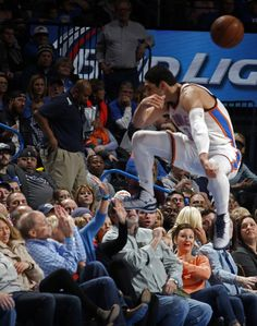 Oklahoma City's Enes Kanter (34) goes into the crowd as he tries to grab a loose ball during the NBA game between the Oklahoma City Thunder and the Denver Nuggets at Chesapeake Energy Arena in Oklahoma City, Sunday, Feb. 22, 2015. Photo by Sarah Phipps, The Oklahoman