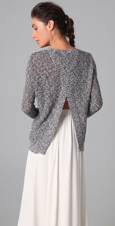 cut the back of a big man's sweater or sweatshirt, then cross over and sew