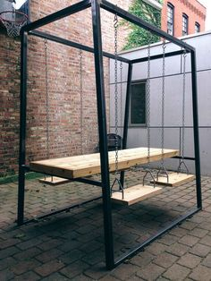 Custom outdoor table with swing-seats. Steel tube frame with cedar top and seats. DIMENSIONS: -80L x 60W x 96H -96L x 60W x 96H Other sizes
