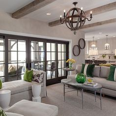 Really like the idea of making the walk-out basement slightly rustic in feel, with beams on the ceiling like shown here and a neutral palette