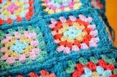 granny squares bordered in blue. love