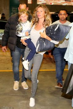 So fly: Gisele Bundchen looked stunning as she jetted out of Rio de Janeiro on Sunday with...