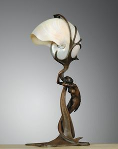 blastedheath:  Gustav Gurschner (Austrian, 1873-1971), A nautilus shell and patinated bronze table lamp, c. 1899