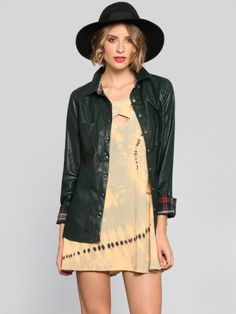 Dark green vegan leather shirt featuring a snap front closure and two pockets at the front