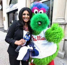 """Former beloved #Detroit news anchor, #SymaChowdry, now in Philly, tweeted: """"The """"Phanatic"""" & I took this picture after he kissed me live on-air yesterday! He is very naughty, but fun!"""" The BEAUTIFUL Syma will be one of our celeb models!!! #Cami"""