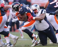 Denver CO 12/18/16 New England Patriots Alan Branch stops Denver Broncos running back Justin Forsett for a 1-yard loss during second quarter action at Sports Authority Field at Mile High Stadium (Photo by Matthew J. Lee/Globe staff) topic: Patriots-Broncos reporter: