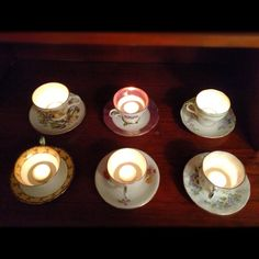 tea cup candles: I put tea lights in the tea cups that my Grandma left to me. They make really pretty candle holders!