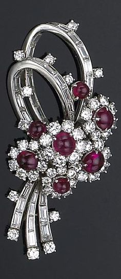 A ruby, diamond and platinum brooch, Harry Winston of floral motif, designed with a cluster of flowers each centering a round ruby cabochon, framed by round brilliant-cut diamonds, accented by looping ribbons of channel-set baguette-cut diamonds; unsigned, attributed to Harry Winston, accompanied by signed box and donation receipt; estimated total diamond weight: 7.10 carats.