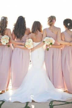 great wedding shot of bride and bridesmaids arm link love