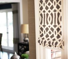 Drape Style: Custom Window Treatments  Shade Fabric: Schumacher Trellis Midnight