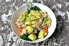 Layered lunch bowl with sweet potatoes, chicken, sauteed spinach and avocado.