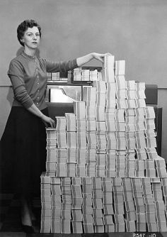 Programmer standing beside punched cards. found on computerhistory.org http://www.cavendishsq.com/