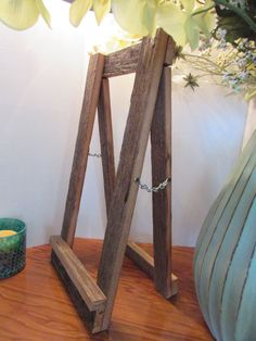 barn wood wooden easel for chalkboards, pictures,  reception schedule itinerary wedding signs , pictures rustic wedding seating chart board a unique style easel made from barn wood to add to any rustic wedding décor can hold up a frame chalkboard or picture LARGER EASEL.. 90.00 48 high  22 x11.....40.00 20 x 10...35.00  use the variation bar for small easel large easel if you need a different size let me know  NEED A DIFFERENT SIZE just let me know, any size can be built just for you all…