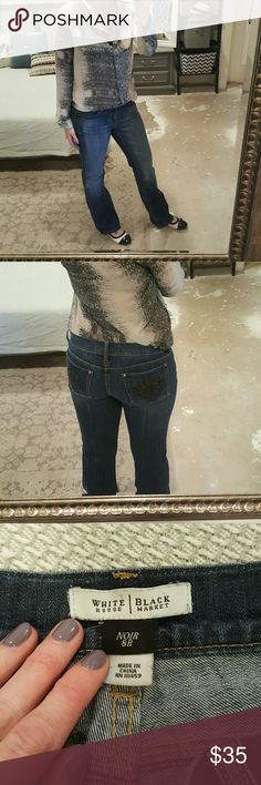 """White House Black Market Jeans I am selling a beautiful and versatile pair of WHBM jeans size 8.  They are so gorgeous in a medium wash with slight whiskering throughout and beautiful black crystal adornments on back pockets.  This particular pair of jeans are a trouser fit with a 31.5"""" inseam.  They are in excellent condition and look perfect with flats!!! White House Black Market Jeans Flare & Wide Leg"""