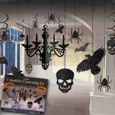 """Add a spooky ceiling to your Halloween or horror party decorations.  Our 17 piece Halloween chandelier kit includes: 1-16"""" black glitter chandelier, 2-5"""" skull cutouts, 2-4 1/2"""" bat cutouts, 2- 7 1/2"""" raven cutouts, 2-5 1/4"""" spider cutouts, 2-3 5/8"""" spider cutouts, 2-24"""" spider swirl decorations, 2-24"""" raven swirl decorations and 2-24"""" skull swirl decorations.  Our spooky chandelier kit is sold by the kit.  Please order in increments of 1 kit."""