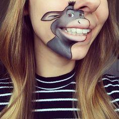 Nuovi personaggi dei cartoni disegnati sulle labbra dalla makeup artist Laura Jenkinson