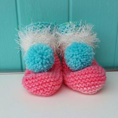 A Super Cute pair of Baby Girls Knitted Booties.....knitted in Soft Acrylic Yarn with a glitter thread, which makes them super sparkly and Soft