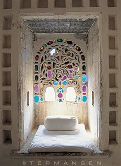 looks so exotic and inviting with the multi-colored glass in the mosaic window frame