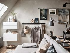 Look at this beautiful small loft project that was done for Ikea. I like the natural colors that are used throughout the interior and the sand color on the wall. This space has a rustic, but still modern look, which works … Continue reading → Attic Rooms, Attic Spaces, Small Spaces, Attic Apartment, Attic Bathroom, Attic Storage, Storage Spaces, Ikea Storage, Attic Organization