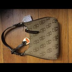 Authentic Dooney and Bourke mini purse Love love love this! This little purse is for a night on the town. This little purse holds more than you think. Or you can put inside a bigger purse to fit all your needs Dooney & Bourke Bags Mini Bags