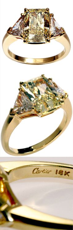 Traditional fancy yellow canary diamond Cartier ring with white diamond trillions. Center rectangular cut-cornered diamond is 3.06 carats with color rated natural fancy yellow. Clarity is VS2. Setting is 18 karat gold. Signed Cartier with inventory numbers: 862225, 937201. GIA report included.