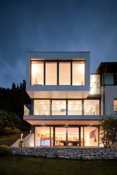 Architecture, Magnificent Architectural Exterior Design Of Lakeside House By Spado Architects With Contemporary Idea Of Lighting Large Glass Wall Besides Extension Of Front And Side Grass Field: Lakeside House among the Lush Greenery and Awesome Interior Concept