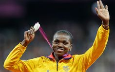 Colombia's Caterine Ibarguen holds her silver medal for the women';s triple jump during the athletics in the Olympic Stadium at the 2012 Summer Olympics, London. Olympic Medals, Triple Jump, 2012 Summer Olympics, Armed Conflict, To Reach, Competition, Athlete, Silver, London