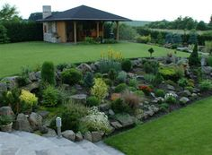 Coming across rock landscaping ideas backyard can be a bit hard but designing a rock garden is one of the most fun and creative forms of Rockery Garden, Sloped Garden, Hillside Garden, Landscaping On A Hill, Landscaping With Rocks, Sloped Backyard Landscaping, Landscaping Ideas, Rock Garden Design, Landscape Design