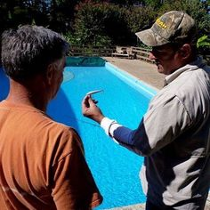 The original Rebel Minnow was tested in 1961 at this swimming pool at Mountain Harbor Resort in #Arkansas before it took the market by storm in 1962. Resort owner Hal Barnes and Rebel owner George Perrin spent many weekends testing and discussing the lures at this pool. Barnes' son, Bill (left), owns @mountainharbor now, and Rebel is led by General Manager Bruce Stanton (right). And Rebel Minnows are still selling in more than 60 countries worldwide! #CatchFishAnywhere #fishing #bassfishing