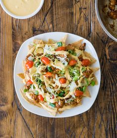 Completely #vegan nachos made from scratch with cashew nacho cheese and maple-chili tempeh crumbles.