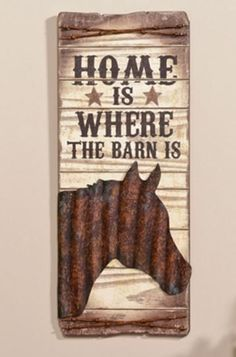 Home is where the barn is! Show off your love for horses with this unique metal and MDF wooden sign. The sign features a metal silhouette of a horse head with barbed-wire on the top and bottom. Any ho